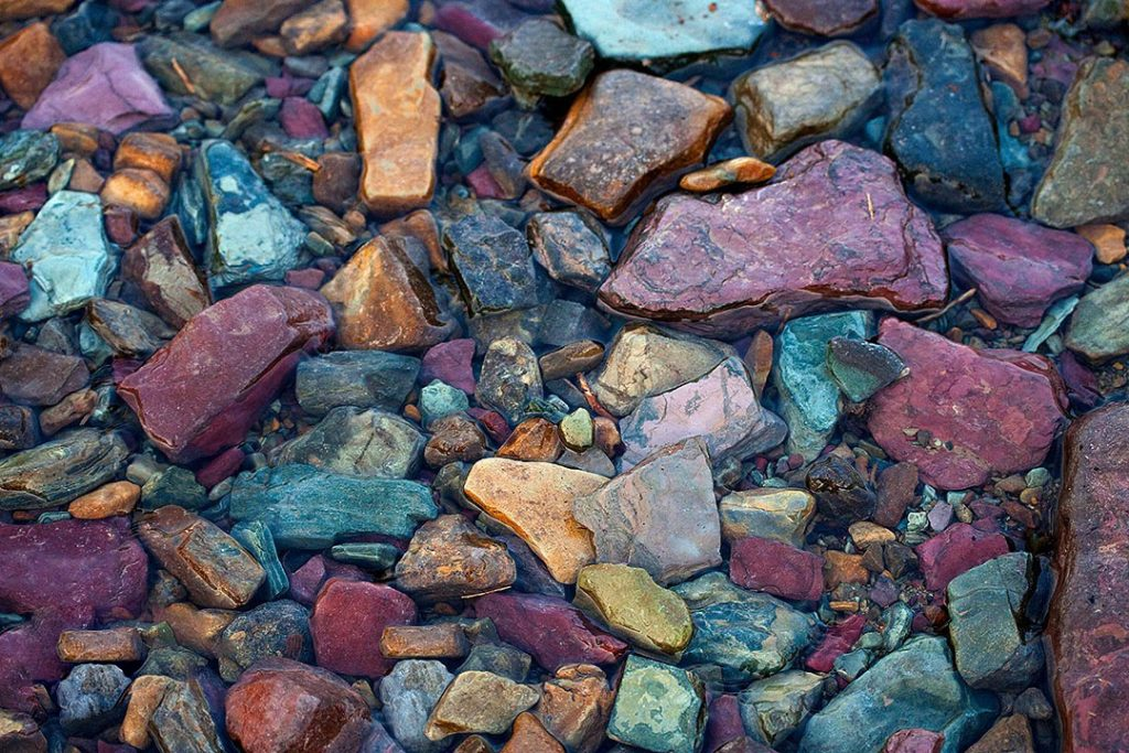 Colorful mudstone rock in Glacier National Park.This picture doesn't have much to do about The End of the Family Home, but it's nice to know that these places are still out there, for now any way.