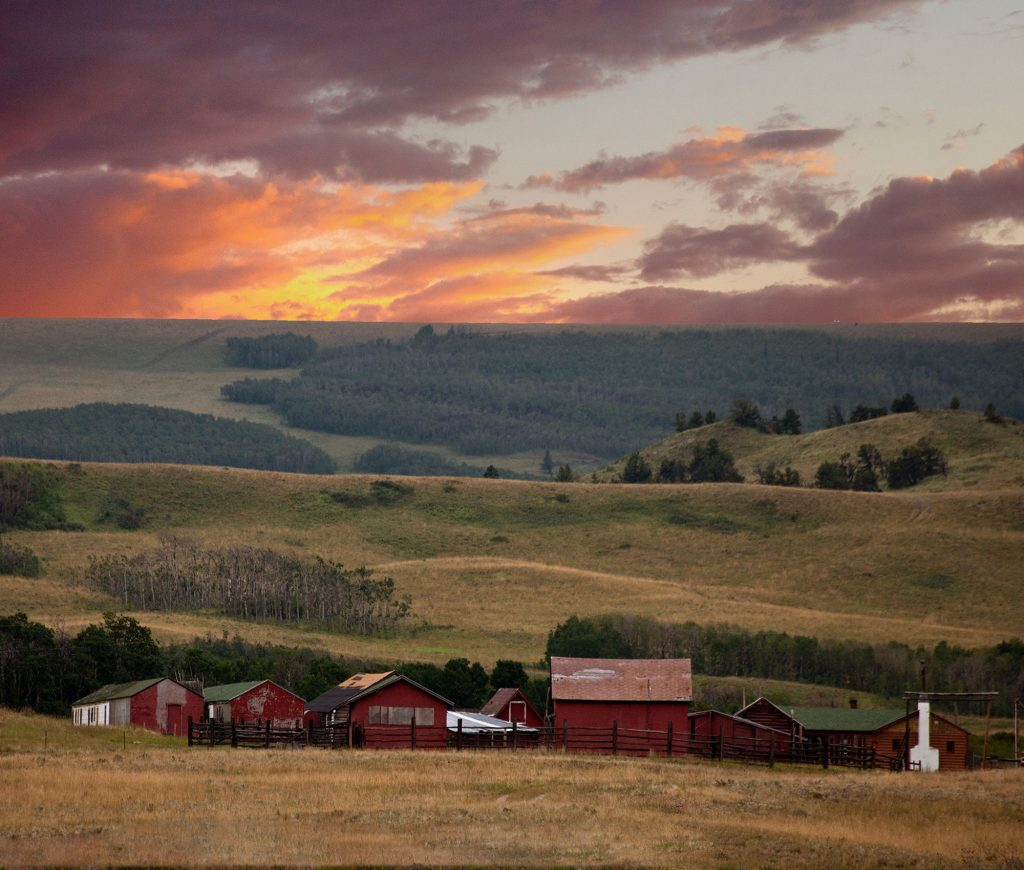 Red Barns, hills and sunset in Montana near Glacier National Park