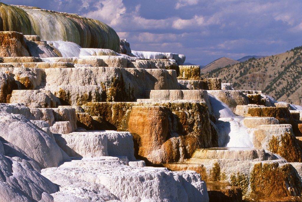 Mammoth Hot springs in Yellowstone National Park as it looked about 20 years ago.  Unfortunately it dried out about ten years ago.  I don't know if this is related to climate change or not, but I think not.  The future of climate change is going to be full of all kinds of difficulties.  But if places like this are to survive we are going to have to overcome them.