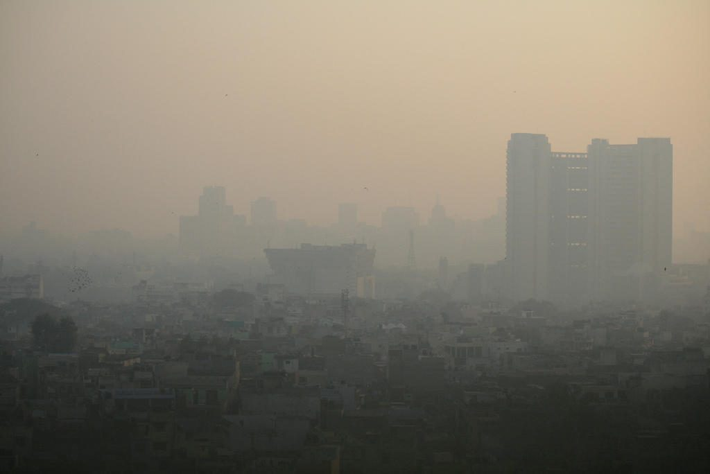 "Smog in Delhi India.  Bill McKibben says that ""half the children in New Delhi have irreversible lung damage simply from breathing the air.""  What a strange world we now live in"
