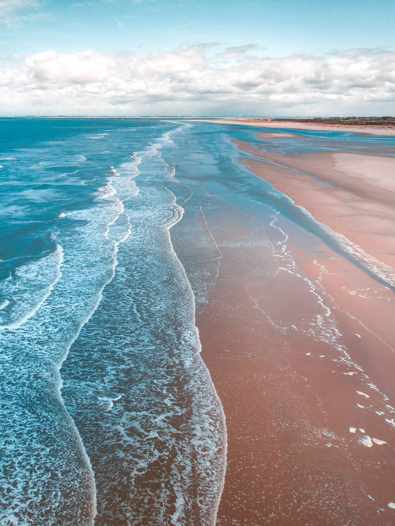 Ocean and beach.  Warming is changing ocean currents and this affects many fisheries, weather, sea levels and much else.