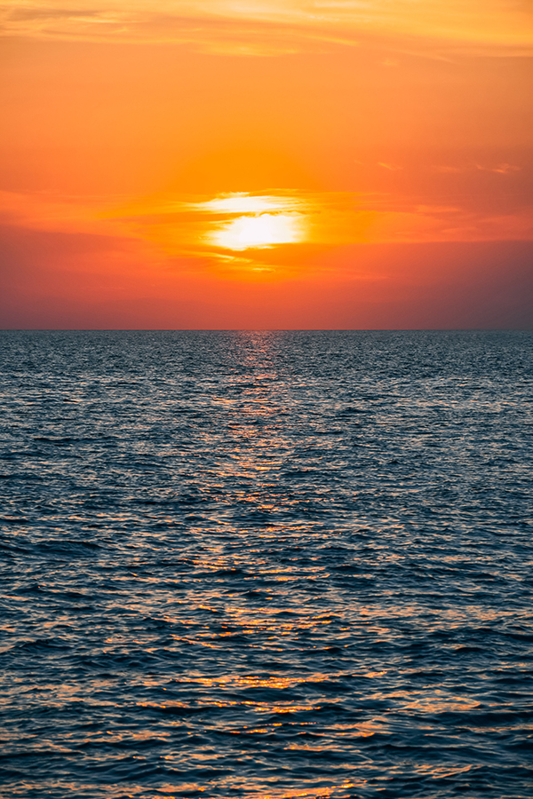 Ocean and setting sun.  Warming is changing ocean currents and this affects many fisheries, weather, sea levels and much else.