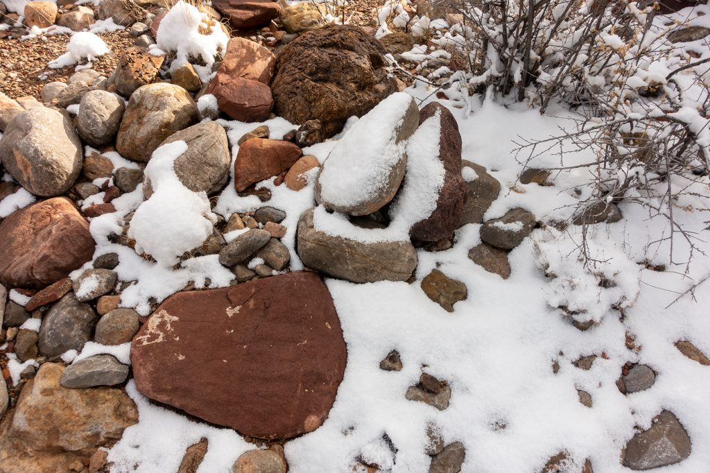 Snowy rocks in a New Mexico arroyo
