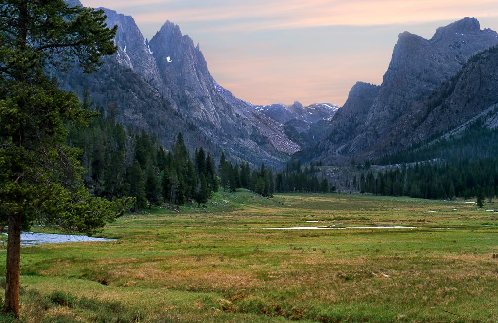 Dawn in a remote valley in the Wind River Mountains of  Wyoming.   Are wars inevitable?  We can choose our our history and save places like this if we try hard enough.