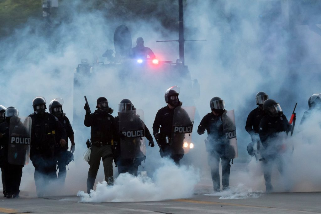 Police-officers-launched-tear-gas-canisters-at-protesters.  Photo from NYT.  William Barr, Trump's Chief Enabler has long parroted Trumps views rather than pointing out that many of Trumps actions are clearly unconstitutional.