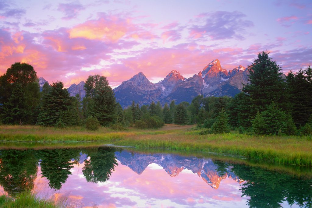 The Tetons at dawn, reflected in a backwater of the Snake River.   I have always lived in places like this between the Great Plains and the Rockies.