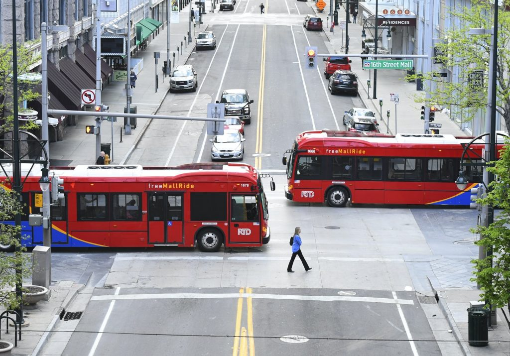 Electric Busses in Denver Colorado.  Electric vehicles powered. by clear renewable electricity are the future of the world
