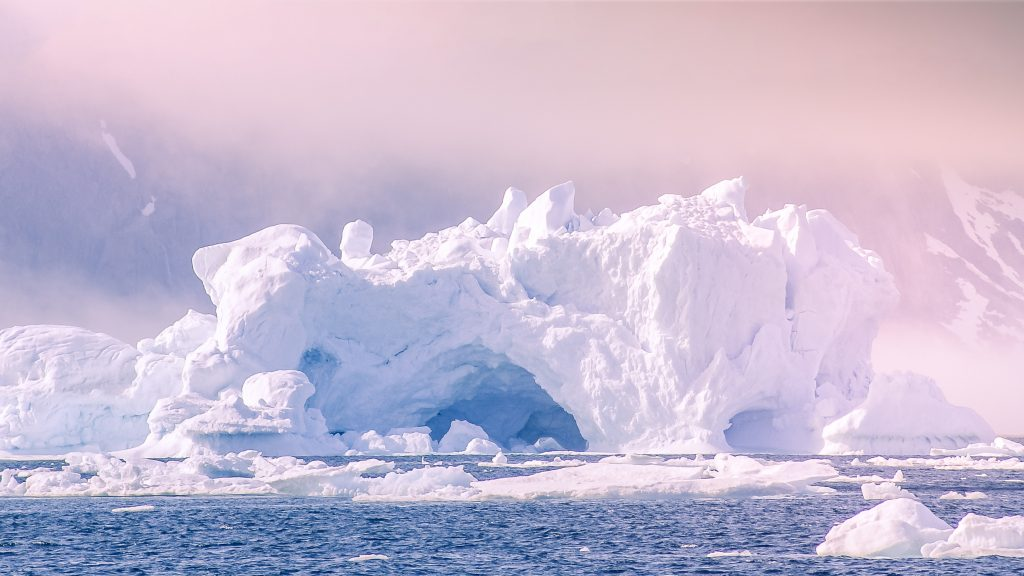 Greenland : an amazing iceberg in the sea.  It won't be long before sea ice like this is gone forever.