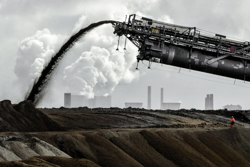 Coal being stock piled at a coal burning electric generation plant.  The world is burning far less coal than it did ten years ago. The coal mined and burned has dropped 50% since 2007.  But this has not even made a tiny blip in the Keeling curve. PPM of CO2 just keep going up and up.