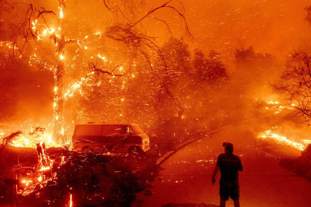 Wildfires are becoming more and more prevalent all over the world.  This is a direct result of global warming.  This is a home burning-in-Orange-County-Calif.-in-the-Bond-Fire