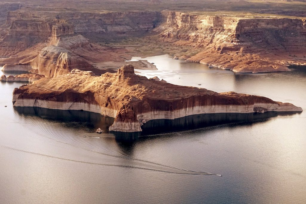 A-high-water-mark-lining-Lake-Powell-near-Page-Ariz.-in-2015.-A-severe-drought-has-gripped-the-American-Southwest-since-2000.  The drought is much worse now and water levers are far lower.