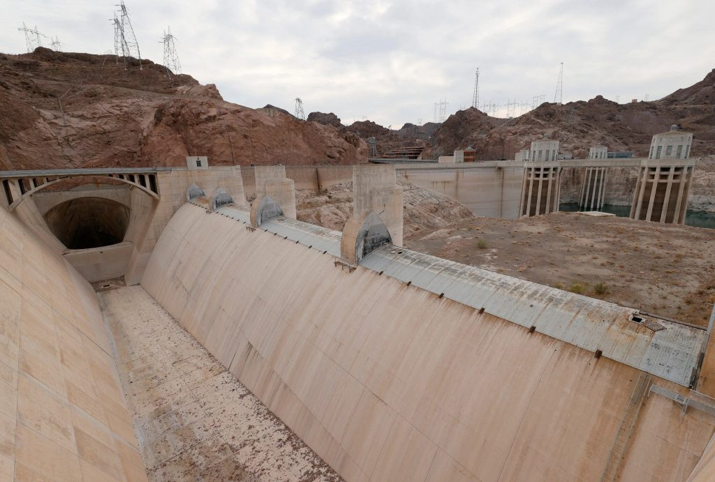 A spillway at Hoover dam is now completely dry.  Why are we letting the world burn?