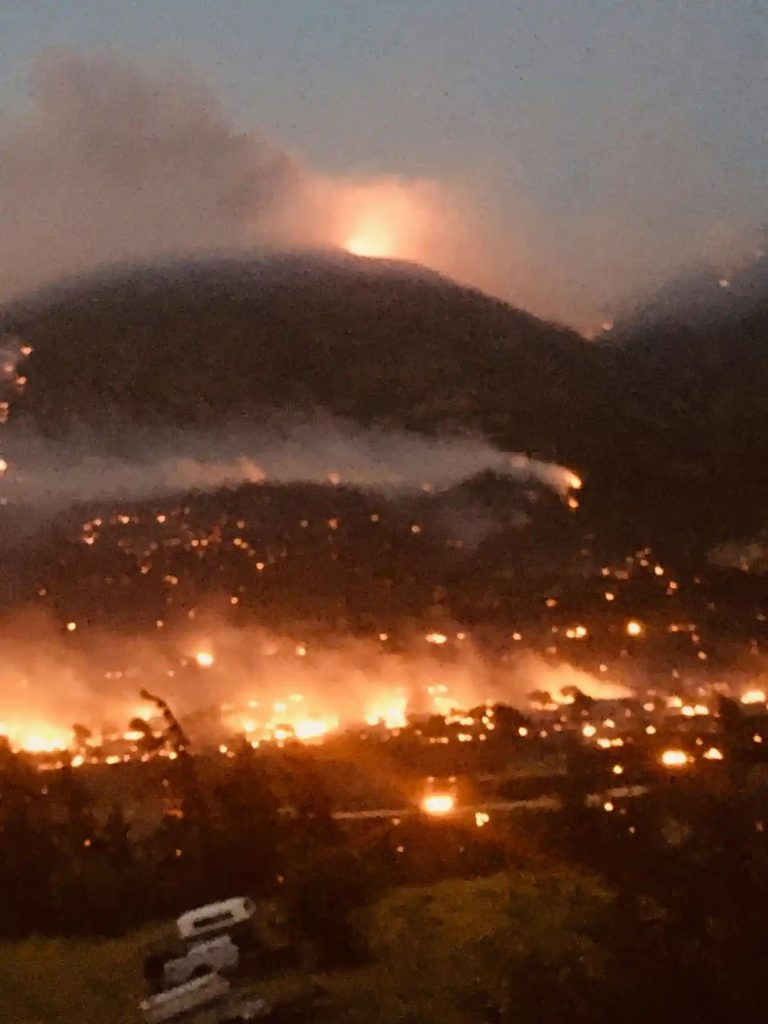 The town of Lytton and surrounding mountains burning.  Why are we letting the world burn?